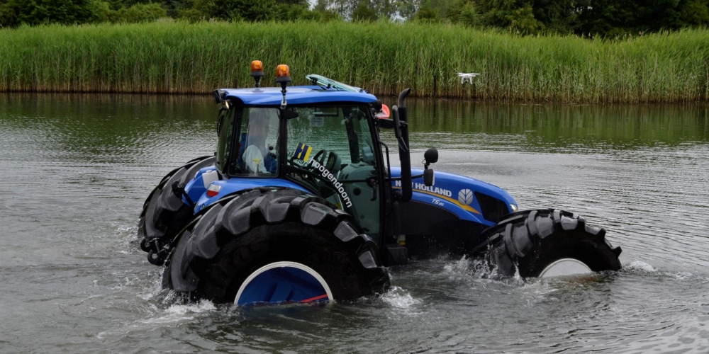 Floating New Holland tractor
